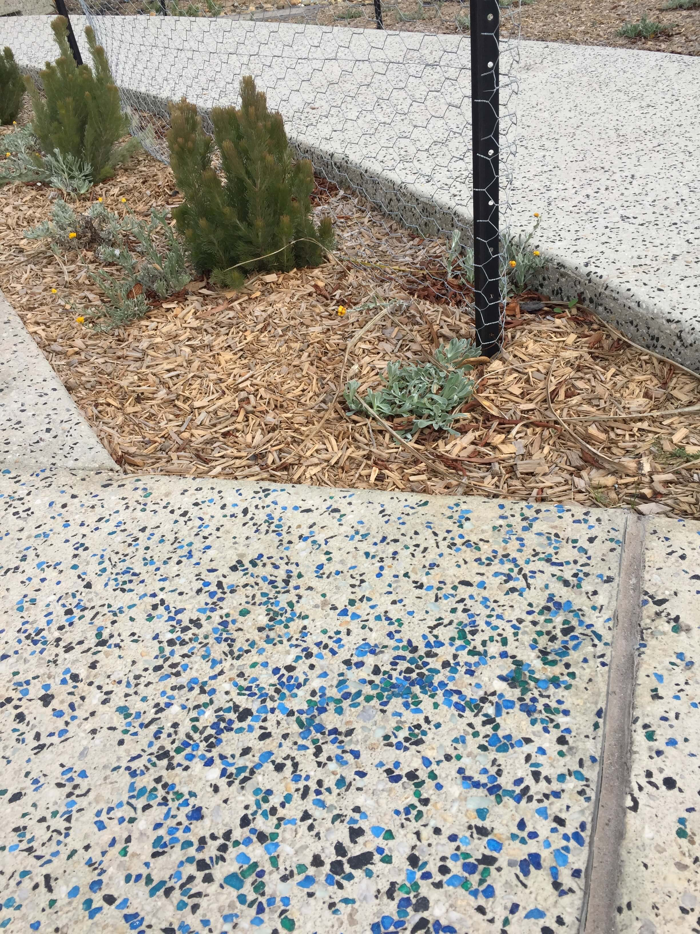 Blue glass in concrete pathway